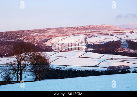 Winter evening light on the Quernmore valley and Clougha Pike near Lancaster Lancashire - Stock Photo