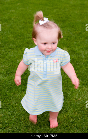 Fourteen Month Old Girl on Grass in Park in La Jolla California - Stock Photo