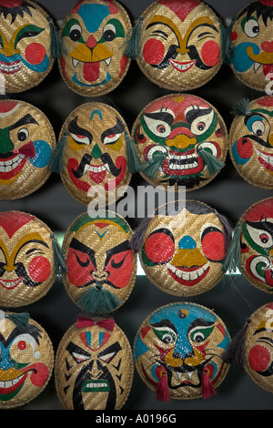 Traditional faces on hand woven baskets display Old Quarter Hanoi Vietnam - Stock Photo