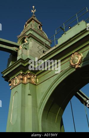 Tower on the Hammersmith suspension bridge, London, England, UK. - Stock Photo