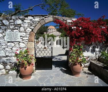 Kloster Thari, Moni Thari, Eingangstor, Torbogen mit Blumenschmuck, Blumenkuebel, Laerma, Rhodos, Dodekanes - Stock Photo