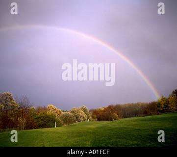 Regenbogen Wiese Herbst rainbow over a golf course weather - Stock Photo