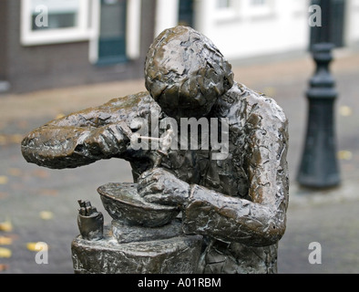 Closeup of Sculpture of a silversmith making silver jewelery Schoonhoven, Southern-Holland, The Netherlands - Stock Photo