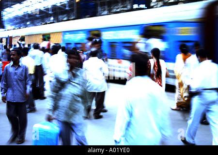 Local suburban electric train rushing commuters leaving Churchgate Railway Station in Bombay now Mumbai Maharashtra - Stock Photo