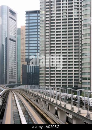 Monorail Train (Yurikamome Line) crossing Shiodome Area. Tokyo. Japan - Stock Photo