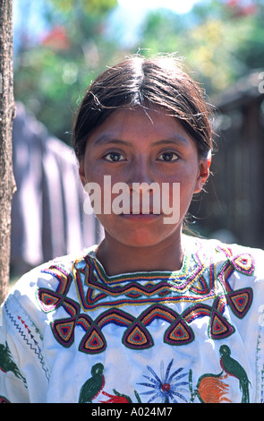 Ixil Maya teenager wearing an embroidered style of blouse which identifies her as from Nebaj - Stock Photo