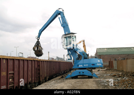 Fuchs MHL 350 loader unloading scrap metal from a train in the uk - Stock Photo