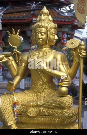 Hinduism a trimurti statue representing the gods Brahma Shiva and Vishnu - Stock Photo