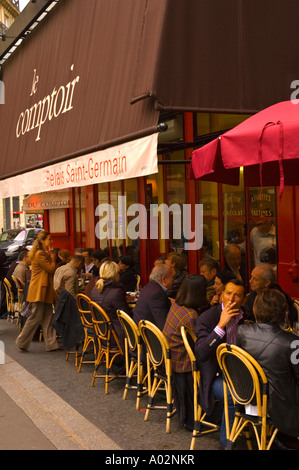 Lunchtime on terrace of Bistro Le Comptoir in the district of Saint Germain des Pres in central Paris the capital - Stock Photo
