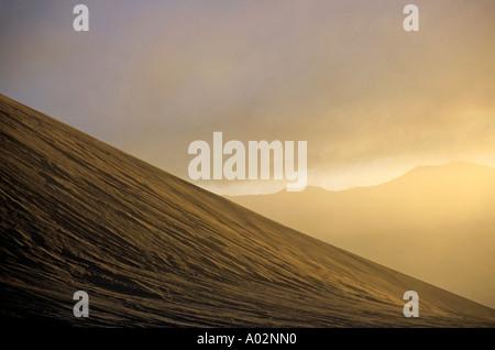 Mount Yasur volcano slope at sunset, Tanna Island, Vanuatu - Stock Photo