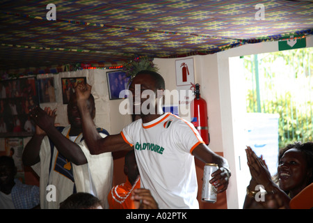 Ivory Coast fans watching 2-1 defeat vs Holland, 2006 World Cup Finals, Xperience African Restaurant, London - Stock Photo