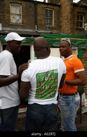 Ivory Coast fans half-time team talk before 2-1 defeat vs Holland, 2006 World Cup Finals, Xperience African Restaurant, - Stock Photo