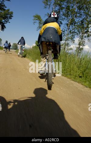 France isere speeding mountain bike on a dirt road - Stock Photo