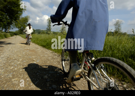 France isere speeding mountain bikers on a dirt road - Stock Photo