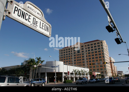 Miami Coral Gables Miami Florida street sign Miracle Mile Ponce De Leon traffic buildings - Stock Photo