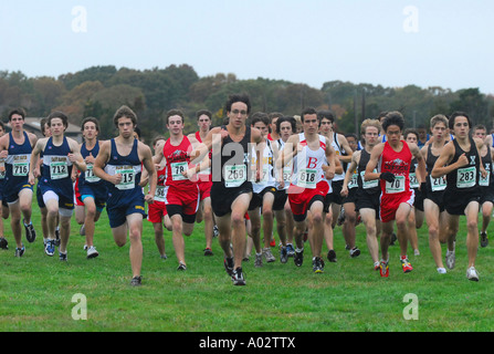 High school Cross country runners take off at the start of the State Championship race in Madison Connecticut USA - Stock Photo