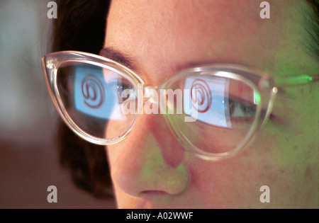 Portrait of a businesswoman with her computer screen reflecting in her glasses, France. - Stock Photo