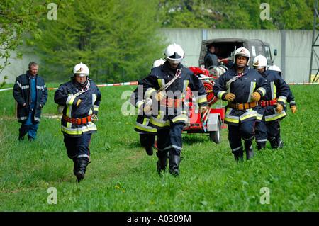 Firefighters running - Stock Photo
