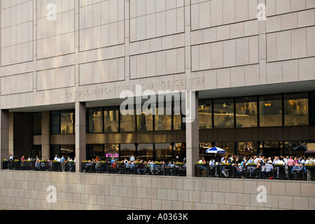 ILLINOIS Chicago Many people on outdoor patio restaurant in hicago Mercantile Exchange Center after work - Stock Photo