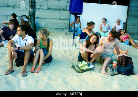 Paris France, 'Public Events' 'Paris Plage' French Relaxing on 'urban Beach' in City Center Along 'Seine River' - Stock Photo