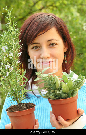 Holding rosemary and sage - Stock Photo