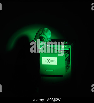 Alien looking for the x files - Stock Photo