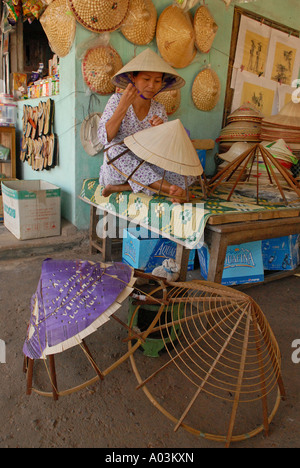 Lady making conical hats in Vietnam - Stock Photo