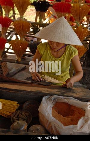 Woman making incense sticks in Tu Du Village Central Vietnam - Stock Photo