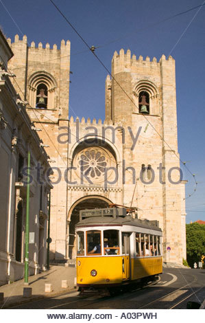 Tram in front of Cathedral Se Alfama Lisbon Portugal - Stock Photo