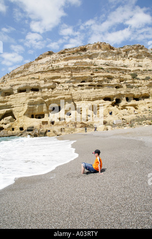 limestone caves at the beach of Matala on the Greek Island of Crete - Stock Photo