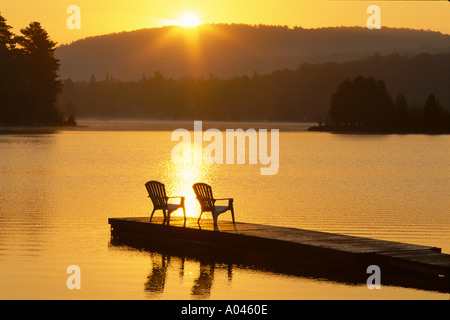 ... Canada Ontario Oxtongue Lake Adirondack Chairs On Dock At Sunrise    Stock Photo