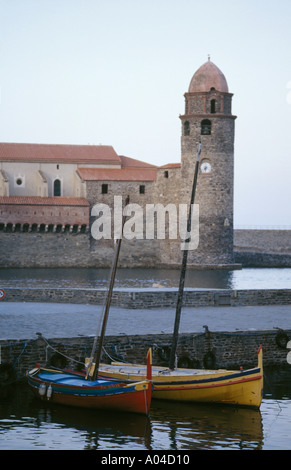 Traditional fishing boats moored quayside in the French mediteranean port of Collioure - Stock Photo