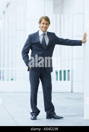 Businessman standing with hand in pocket, full length - Stock Photo