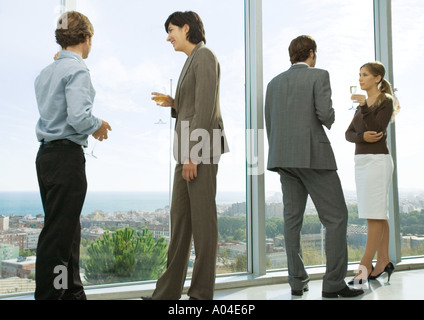 Cocktail party, cityscape and sea seen through window - Stock Photo