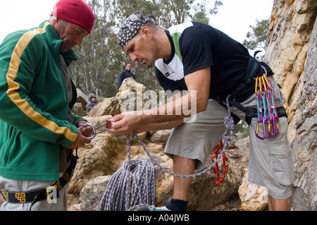 Image of two male rock climbers about to embark on their ascent - Stock Photo