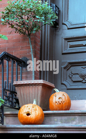 Medium close up image of pumpkins on doorstep of a house in the historic district Savannah Georgia USA. - Stock Photo