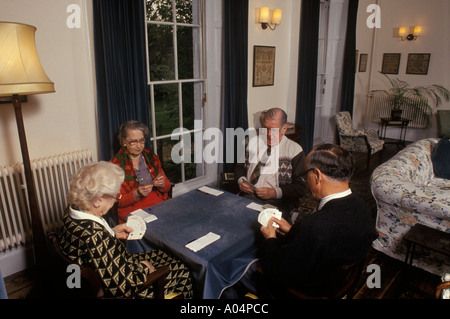Four old age pensioners playing bridge residential home Gloucestershire England HOMER SYKES - Stock Photo