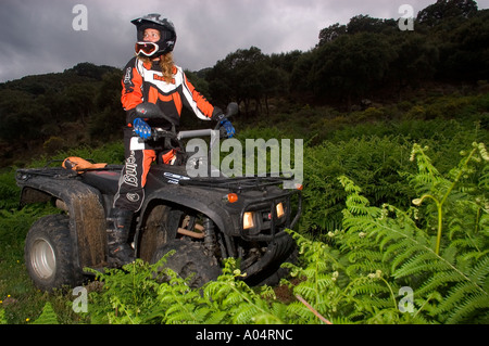 Female Quad Rider in the Countryside - Stock Photo
