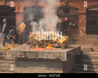 PASUPATINATH NEPAL November A cremation ceremony on one of the Ghats at this site of the Holy Temple of Lord Shiva - Stock Photo