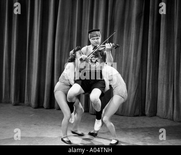 BENNY HILL UK comedian in 1957 rehearsing for his TV show - Stock Photo