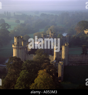 Misty autumn morning Warwick castle and River Avon UK aerial view - Stock Photo