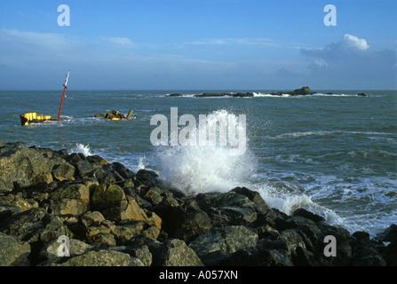 Shipwreck off the coast of Mousehole village, West Cornwall, UK - Stock Photo