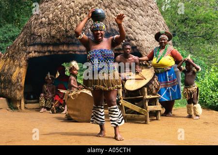 South Africa, Phe-zulu, Zulu Woman Dancing - Stock Photo
