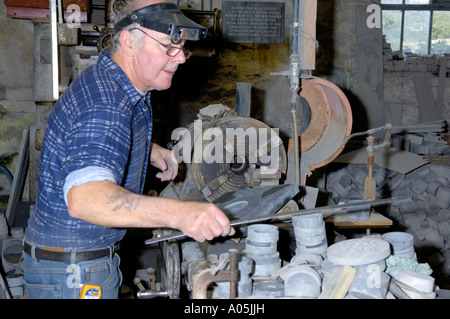 Craftsman Turning a Piece of Slate on Lathe Inside Workshop Inigo Jones Slate Works Groeslon North West Wales - Stock Photo