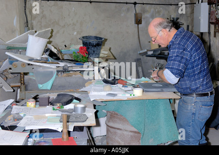 Craftsman Working on Piece of Slate on Lathe Inside Workshop Inigo Jones Slate Works Groeslon North West Wales - Stock Photo