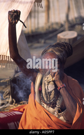 Sadhu who kept his arm above his head for a decade. Khumb Mela festival 2001-Allahabad, Uttar Pradesh, India. - Stock Photo