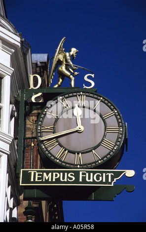 old father time on ornate clock on side of historic dysons jewellers building dating from 1865 leeds uk - Stock Photo