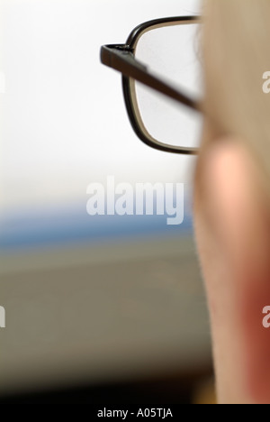 Woman Looking at a Computer Screen, Close Up. - Stock Photo