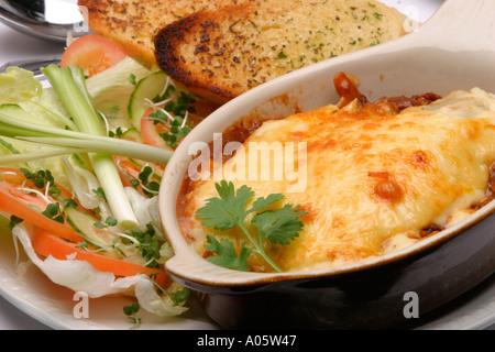 Food Italian Main Course Lasagne and salad with garlic bread - Stock Photo