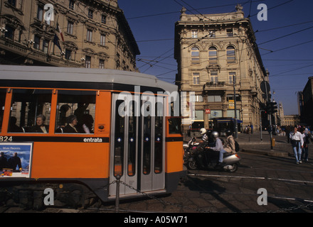 a tram crossing piazza Cordusio Milan Lombardy Italy - Stock Photo